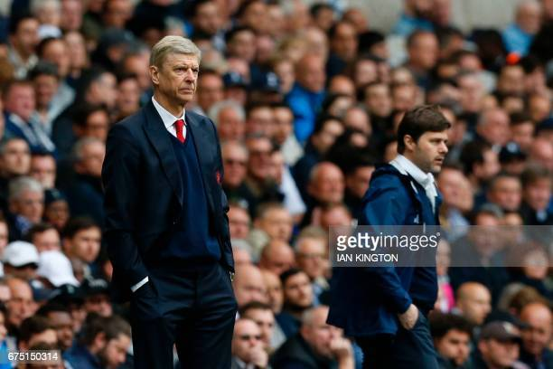 Arsenal's French manager Arsene Wenger and Tottenham Hotspur's Argentinian head coach Mauricio Pochettino watch during the English Premier League...