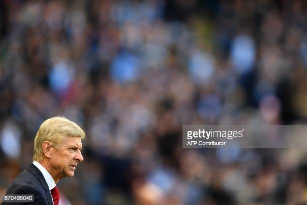 Arsenal's French manager Arsene Wenger arives on the pitch ahead of the English Premier League football match between Manchester City and Arsenal at...