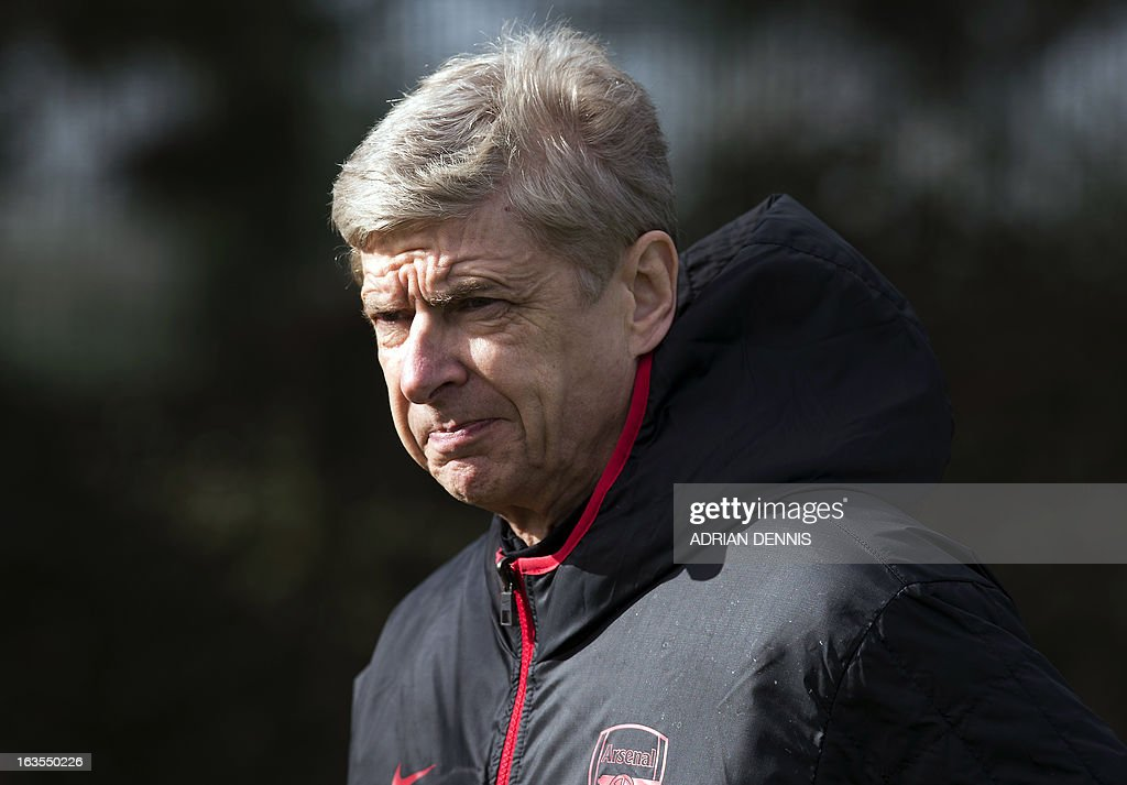 Arsenal's French manager Arsene Wenger arrives at the pitch for a training session at the club's complex in London Colney on March 12, 2013 ahead of the team's last 16 UEFA Champions League football match against Bayern Munich in Germany on March 13. AFP PHOTO / ADRIAN DENNIS