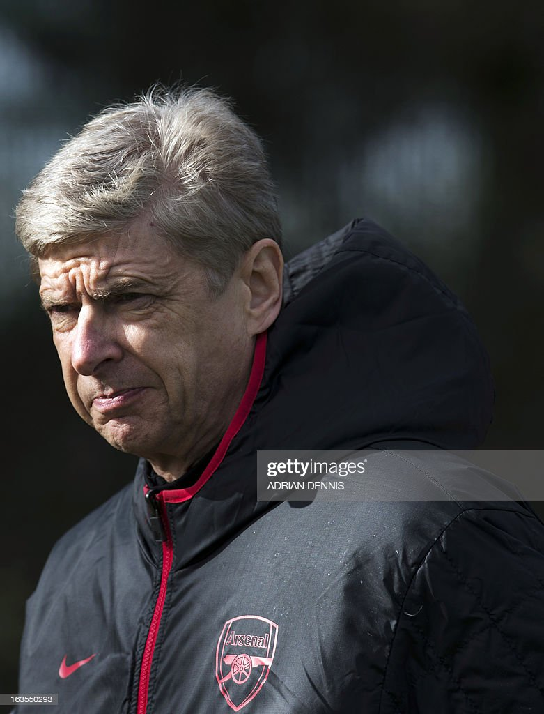 Arsenal's French manager Arsene Wenger arrives at the pitch for a training session at the club's complex in London Colney on March 12, 2013 ahead of the team's last 16 UEFA Champions League football match against Bayern Munich in Germany on March 13.