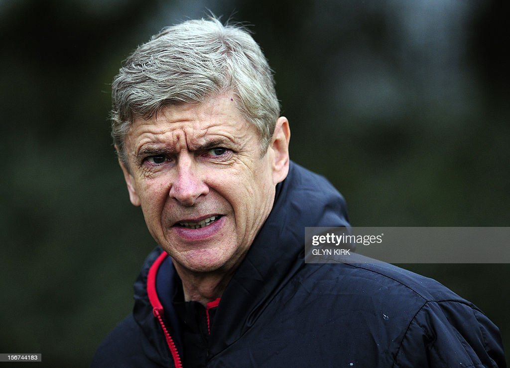 Arsenal's French manager Arsene Wenger attends training at Arsenal's training facility in London Colney in Hertfordshire north of London on November 20, 2012 on the eve of their UEFA Champions League group B football match against Montpellier. AFP PHOTO / GLYN KIRK