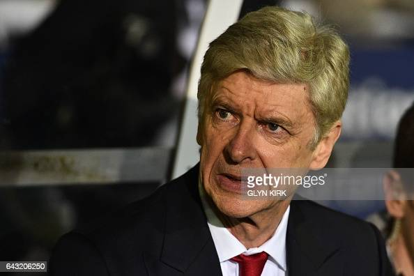 Arsenal's French manager Arsene Wenger awaits kick off in the English FA Cup fifth round football match between Sutton United and Arsenal at the...