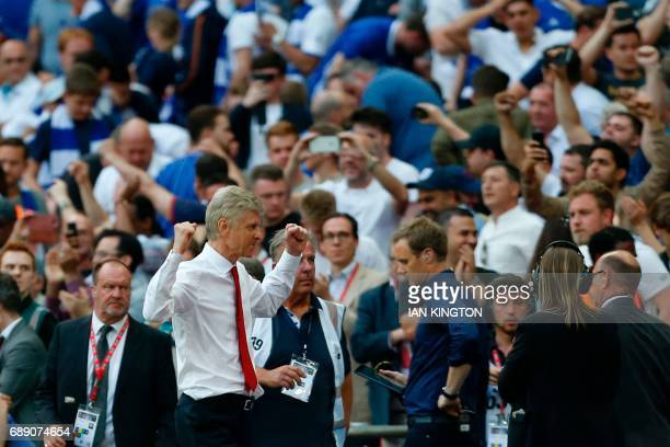 Arsenal's French manager Arsene Wenger celebrates at the final whistle in the English FA Cup final football match between Arsenal and Chelsea at...