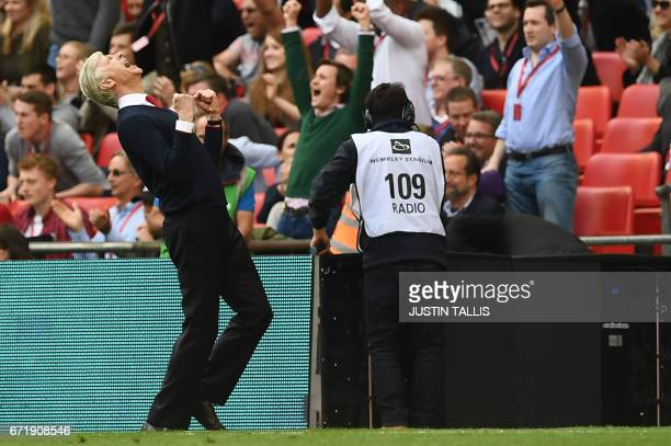 Arsenal's French manager Arsene Wenger celebrates victory after the FA Cup semifinal football match between Arsenal and Manchester City at Wembley...
