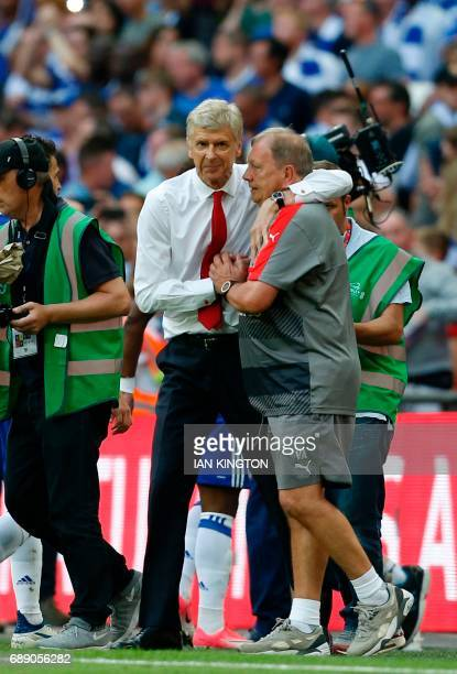 Arsenal's French manager Arsene Wenger celebrates with kit manager Vic Akers on the pitch after the English FA Cup final football match between...