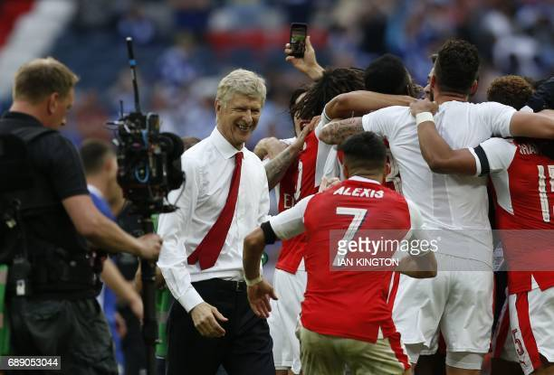 Arsenal's French manager Arsene Wenger celebrates with the players on the pitch after the English FA Cup final football match between Arsenal and...