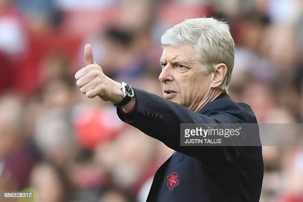Arsenal's French manager Arsene Wenger gestures from the touchline during the English Premier League football match between Arsenal and Everton at...