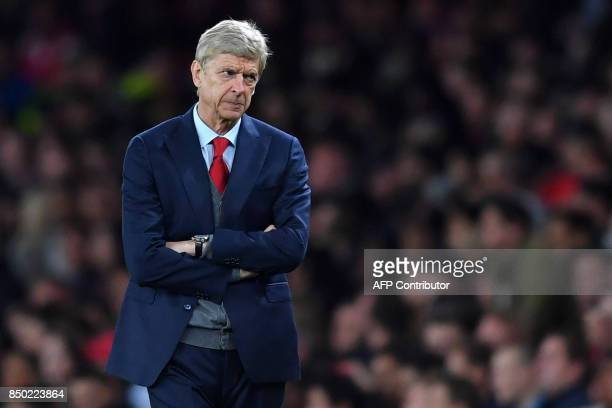 Arsenal's French manager Arsene Wenger gestures on the touchline during the English League Cup third round football match between Arsenal and...