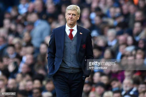 Arsenal's French manager Arsene Wenger gestures on the touchline during the English Premier League football match between Manchester City and Arsenal...