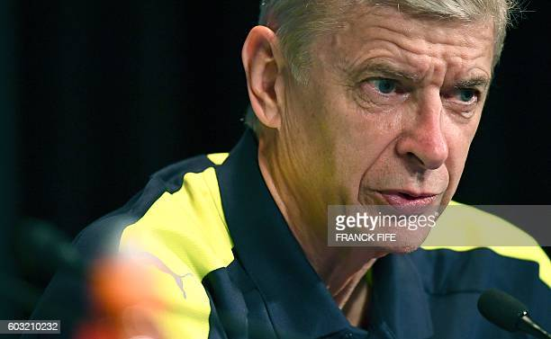 Arsenal's French manager Arsene Wenger gives a press conference on the eve of the team's UEFA Champions League football match against Paris...