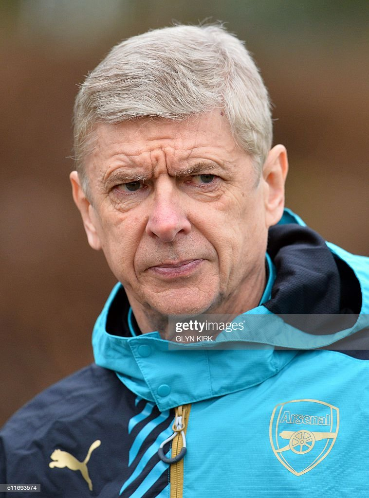 Arsenal's French manager Arsene Wenger is pictured as he takes part in a training session ahead of the UEFA Champions League round of 16 1st leg football match against Barcelona at Arsenal's London Colney training ground on February 22, 2016. Arsenal will play against Barcelona at the Emirates Stadium in London on Tuesday February 23, 2016. / AFP / GLYN