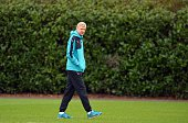 Arsenal's French manager Arsene Wenger is pictured as he takes part in a training session ahead of the UEFA Champions League round of 16 1st leg...