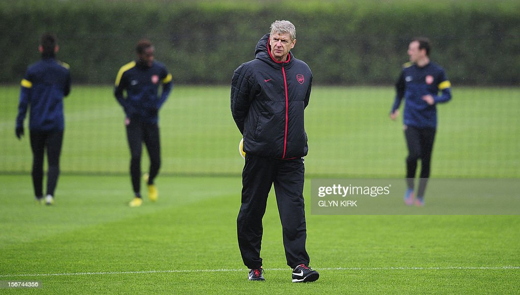 Arsenal's French manager Arsene Wenger leads a training session at Arsenal's training facility in London Colney in Hertfordshire north of London on November 20, 2012 on the eve of their UEFA Champions League group B football match against Montpellier. AFP PHOTO / GLYN KIRK