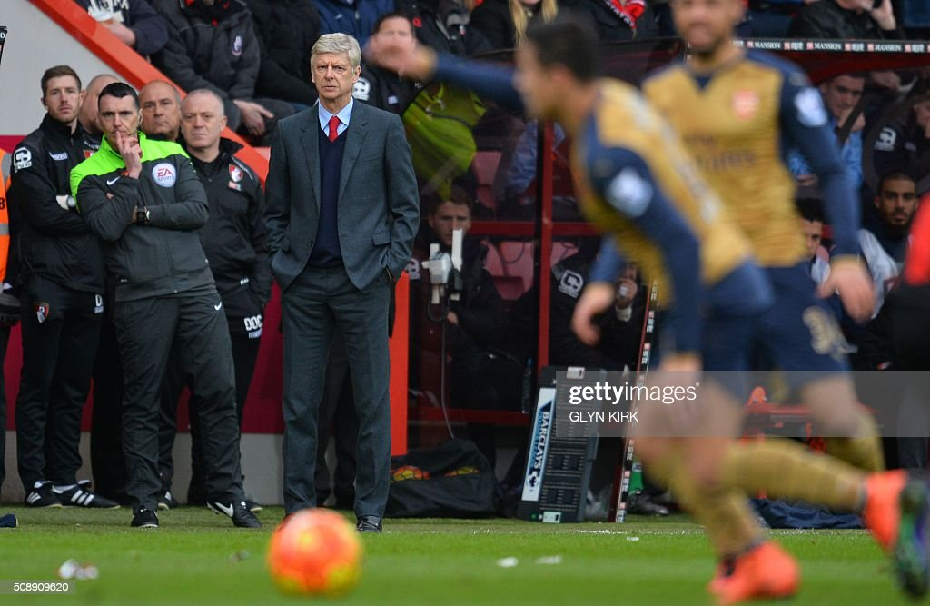 Arsenal's French manager Arsene Wenger (C) looks on during the English Premier League football match between Bournemouth and Arsenal at the Vitality Stadium in Bournemouth, southern England on February 7, 2016. / AFP / GLYN KIRK / RESTRICTED TO EDITORIAL USE. No use with unauthorized audio, video, data, fixture lists, club/league logos or 'live' services. Online in-match use limited to 75 images, no video emulation. No use in betting, games or single club/league/player publications. /