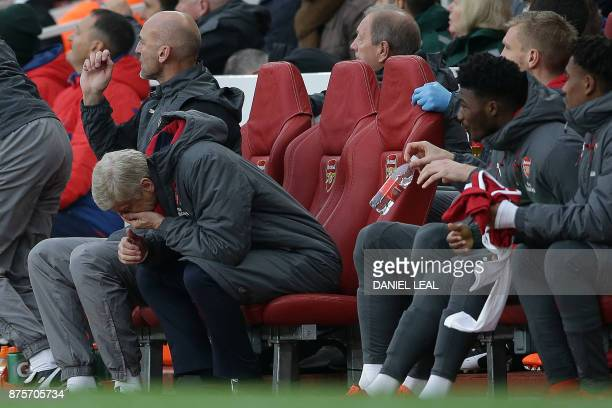 Arsenal's French manager Arsene Wenger reacts during the English Premier League football match between Arsenal and Tottenham Hotspur at the Emirates...