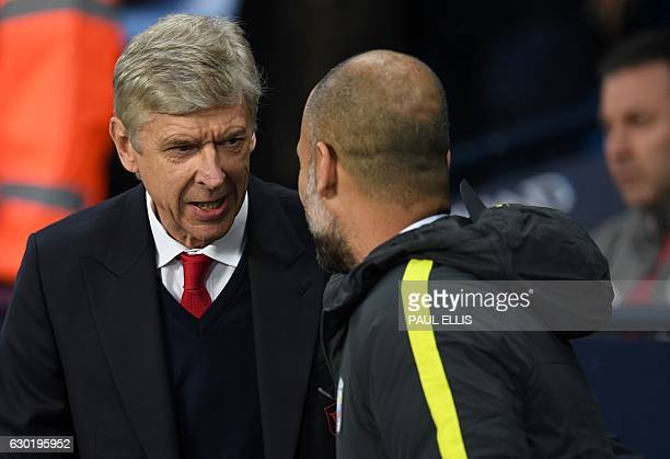 Arsenal's French manager Arsene Wenger shakes hands with Manchester City's Spanish manager Pep Guardiola before the English Premier League football...