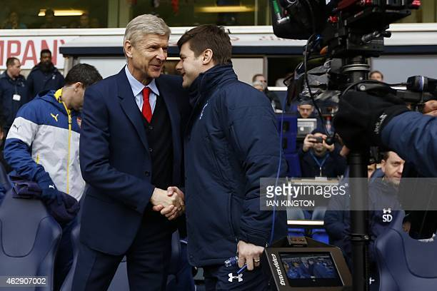 Arsenal's French manager Arsene Wenger shakes hands with Tottenham Hotspur's Argentinian head coach Mauricio Pochettino before kick off of the...