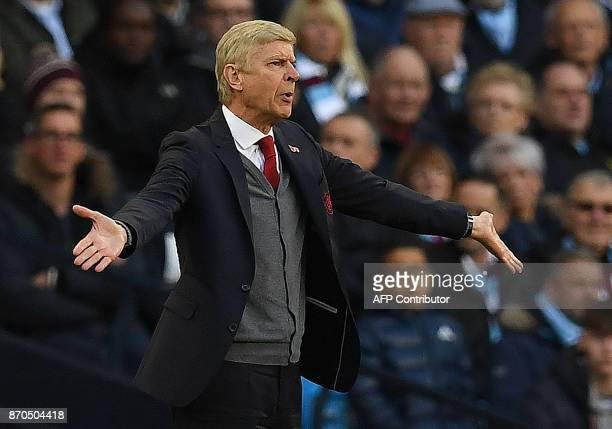Arsenal's French manager Arsene Wenger shouts instructions to his players from the touchline during the English Premier League football match between...