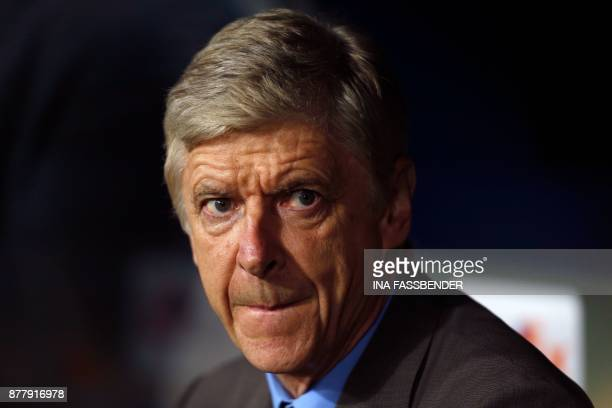 Arsenal's French manager Arsene Wenger sits on the bench prior to the UEFA Europa League football match 1 FC Cologne v Arsenal FC on November 23 2017...