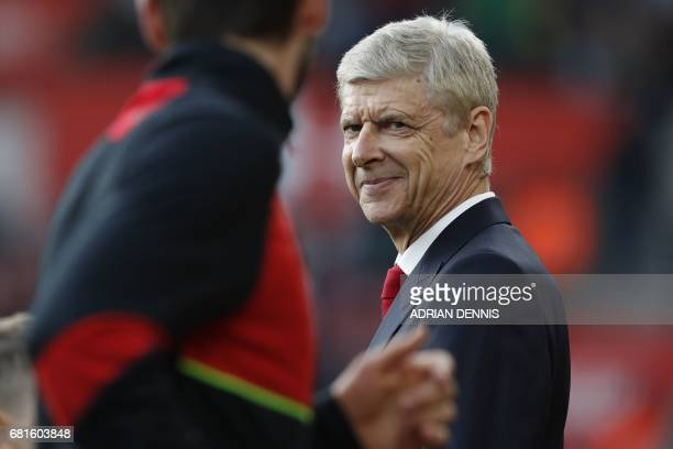 Arsenal's French manager Arsene Wenger smiles ahead of the English Premier League football match between Southampton and Arsenal at St Mary's Stadium...