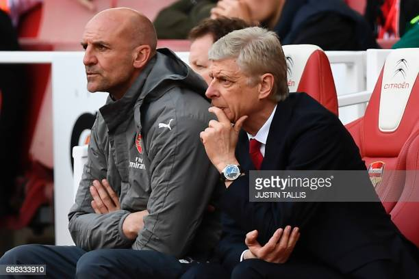 Arsenal's French manager Arsene Wenger watches during the English Premier League football match between Arsenal and Everton at the Emirates Stadium...