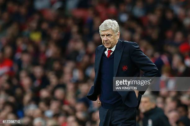 Arsenal's French manager Arsene Wenger watches from the touchline during the English Premier League football match between Arsenal and Middlesbrough...
