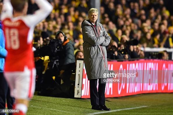 Arsenal's French manager Arsene Wenger watches from the touchline during the English FA Cup fifth round football match between Sutton United and...