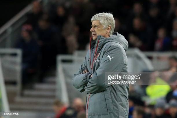 Arsenal's French manager Arsene Wenger watches his players from the touchline during the English Premier League football match between Middlesbrough...