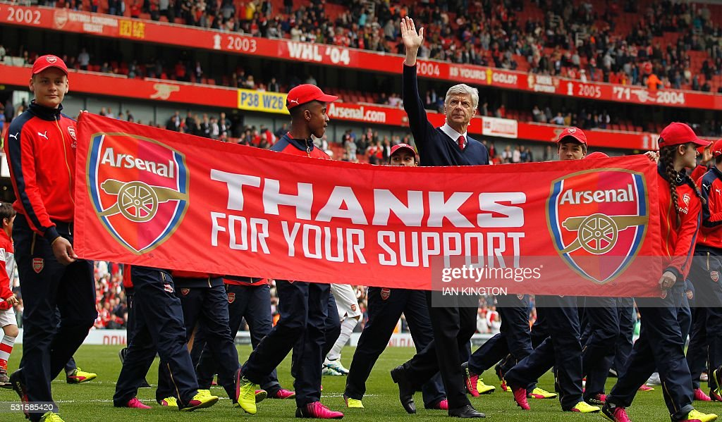 TOPSHOT - Arsenal's French manager Arsene Wenger waves to the fans following the English Premier League football match between Arsenal and Aston Villa at the Emirates Stadium in London on May 15, 2016. / AFP / Ian Kington / RESTRICTED TO EDITORIAL USE. No use with unauthorized audio, video, data, fixture lists, club/league logos or 'live' services. Online in-match use limited to 75 images, no video emulation. No use in betting, games or single club/league/player publications. /