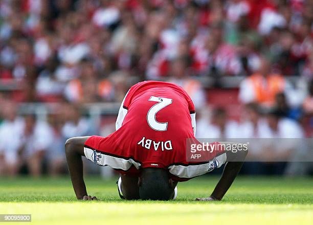 Arsenal's French midfielder Abou Diaby goes down injured during the Premier League football match between Arsenal and Portsmouth at The Emirates...