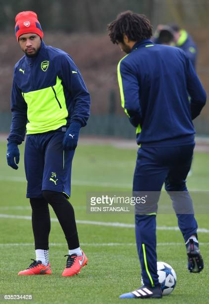 Arsenal's French midfielder Francis Coquelin and Arsenal's Egyptian midfielder Mohamed Elneny take part in a training session on the eve of their...