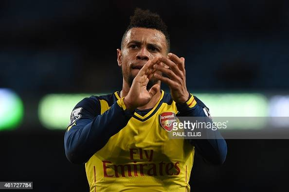 Arsenal's French midfielder Francis Coquelin applauds at the end of the English Premier League football match between Manchester City and Arsenal at...
