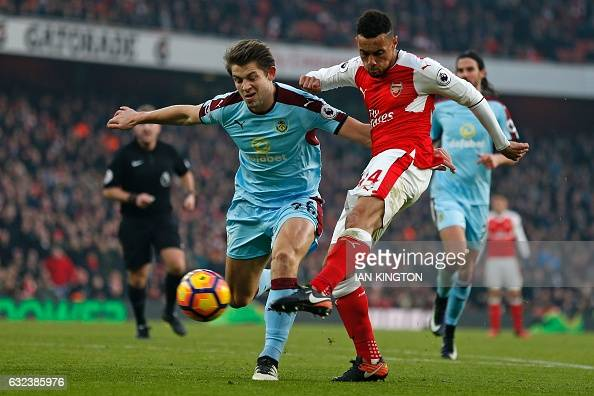 Arsenal's French midfielder Francis Coquelin has an unsuccessful shot under pressure from Burnley's English defender James Tarkowski during the...