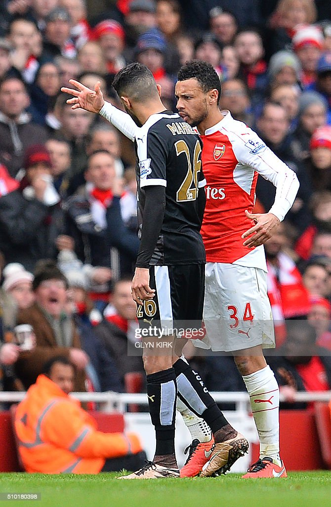 Arsenal's French midfielder Francis Coquelin (R) reacts as he speaks with Leicester City's Algerian midfielder Riyad Mahrez during the English Premier League football match between Arsenal and Leicester at the Emirates Stadium in London on February 14, 2016. / AFP / GLYN KIRK / RESTRICTED TO EDITORIAL USE. No use with unauthorized audio, video, data, fixture lists, club/league logos or 'live' services. Online in-match use limited to 75 images, no video emulation. No use in betting, games or single club/league/player publications. /