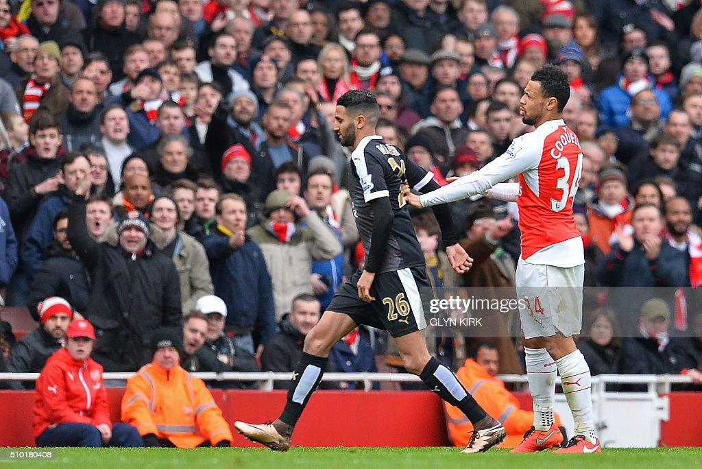 Arsenal's French midfielder Francis Coquelin (R) scuffles with Leicester City's Algerian midfielder Riyad Mahrez during the English Premier League football match between Arsenal and Leicester at the Emirates Stadium in London on February 14, 2016. / AFP / GLYN KIRK / RESTRICTED TO EDITORIAL USE. No use with unauthorized audio, video, data, fixture lists, club/league logos or 'live' services. Online in-match use limited to 75 images, no video emulation. No use in betting, games or single club/league/player publications. /