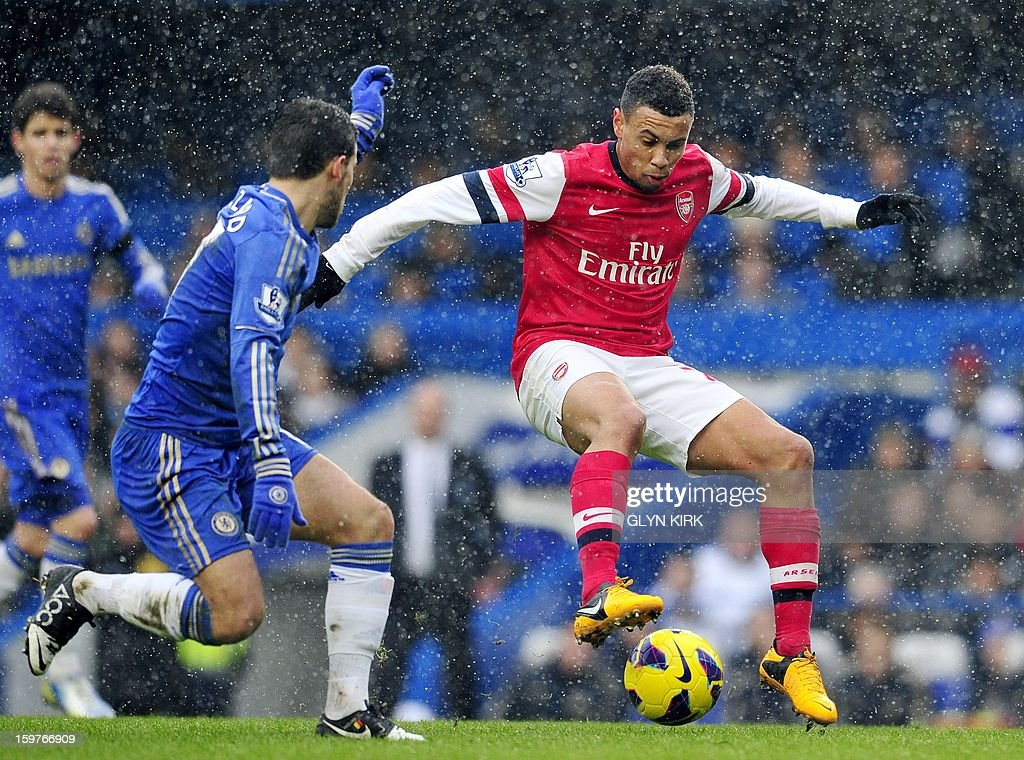 "Arsenal's French midfielder Francis Coquelin (R) vies with Chelsea's Belgian midfielder Eden Hazard (L) during their English Premier League football match at Stamford Bridge in London, England on January 20, 2013. AFP PHOTO/Glyn KIRK - RESTRICTED TO EDITORIAL USE. No use with unauthorized audio, video, data, fixture lists, club/league logos or ""live"" services. Online in-match use limited to 45 images, no video emulation. No use in betting, games or single club/league/player publications."