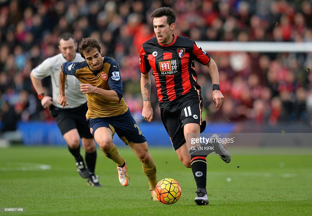 Arsenal's French midfielder Mathieu Flamini (L) vies with Bournemouth's English midfielder Charlie Daniels during the English Premier League football match between Bournemouth and Arsenal at the Vitality Stadium in Bournemouth, southern England on February 7, 2016. / AFP / GLYN KIRK / RESTRICTED TO EDITORIAL USE. No use with unauthorized audio, video, data, fixture lists, club/league logos or 'live' services. Online in-match use limited to 75 images, no video emulation. No use in betting, games or single club/league/player publications. /