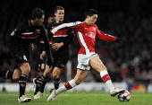 Arsenal's French midfielder Samir Nasri runs with the ball past AZ Alkmaar's Mexican player Hector Moreno during the Champions League Group H...