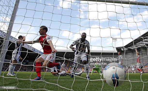 Arsenal's French player Laurent Koscielny scores his goal during an English Premier League football match between West Bromwich Albion and Arsenal at...