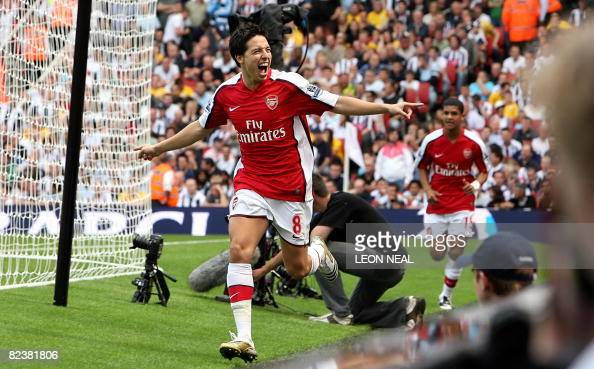 Arsenal's French player Samir Nasri celebrates his early goal against West Bromwich Albion during the first match of the new season at the Emirates...