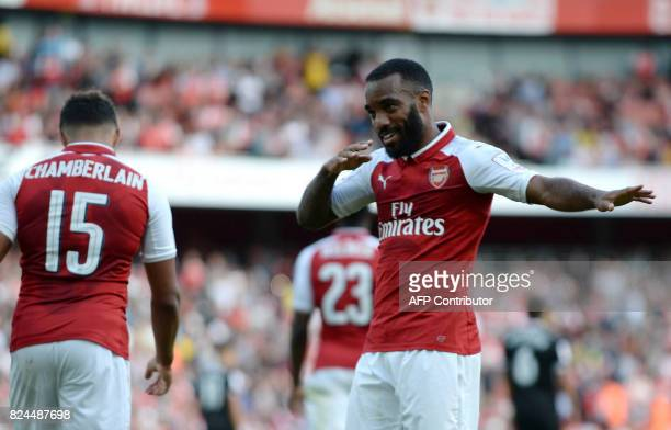 Arsenal's French striker Alexandre Lacazette celebrates scoring the team's first goal during the preseason friendly football match between Arsenal...