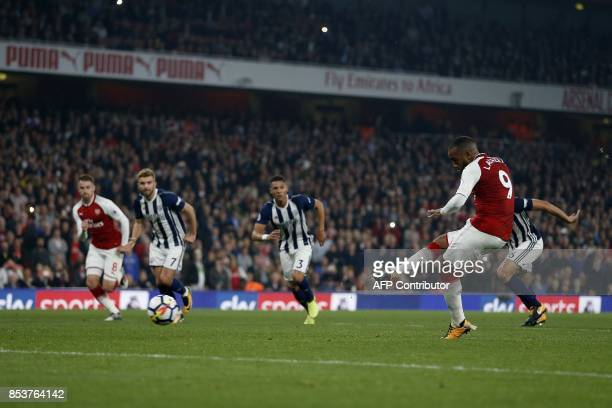 TOPSHOT Arsenal's French striker Alexandre Lacazette shoots from the penalty spot to score his team's second goal during the English Premier League...