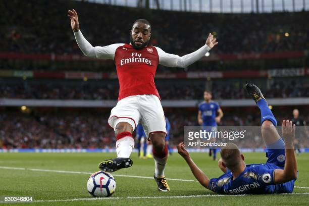 Arsenal's French striker Alexandre Lacazette vies with Leicester City's English midfielder Marc Albrighton during the English Premier League football...