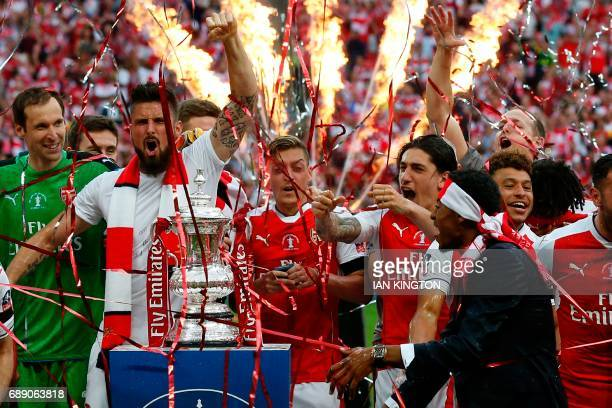Arsenal's French striker Olivier Giroud and teammates celebrate their win over Chelsea on the pitch after the English FA Cup final football match...