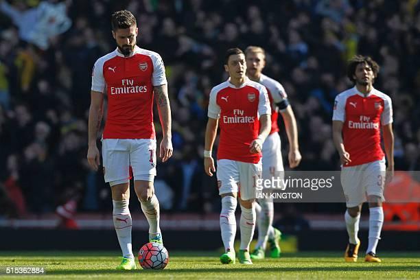Arsenal's French striker Olivier Giroud Arsenal's German midfielder Mesut Ozil Arsenal's German defender Per Mertesacker and Arsenal's Egyptian...