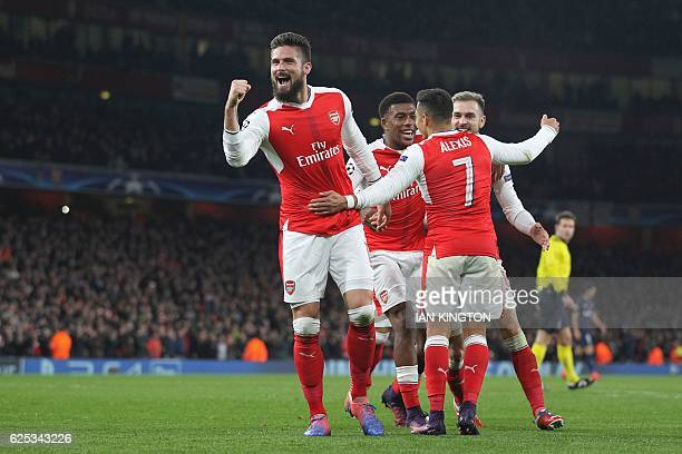 Arsenal's French striker Olivier Giroud celebrates after Paris SaintGermain's Italian midfielder Marco Verratti scored an own goal for Arsenal's...