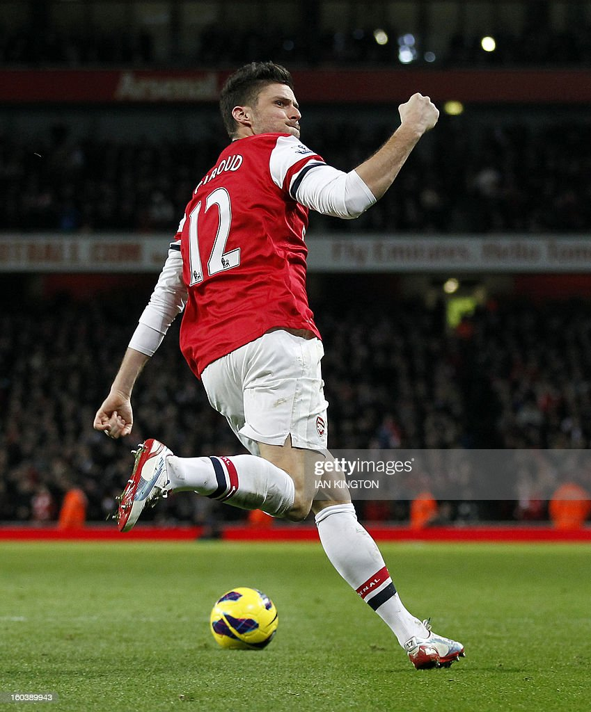 "Arsenal's French striker Olivier Giroud celebrates scoring Arsenal's first goal during the English Premier League football match between Arsenal and Liverpool at The Emirates Stadium in north London on January 30, 2013. USE. No use with unauthorized audio, video, data, fixture lists, club/league logos or ""live"" services. Online in-match use limited to 45 images, no video emulation. No use in betting, games or single club/league/player publications."