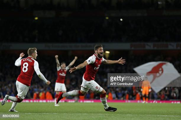 Arsenal's French striker Olivier Giroud celebrates scoring Arsenal's fourth goal during the English Premier League football match between Arsenal and...