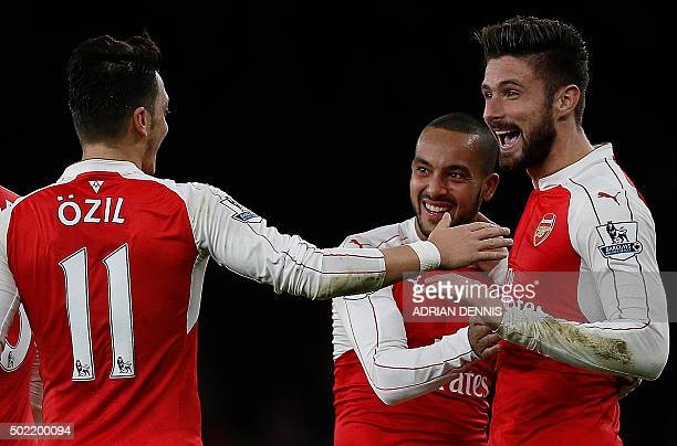 Arsenal's French striker Olivier Giroud celebrates scoring his team's second goal with Arsenal's English midfielder Theo Walcott and Arsenal's German...