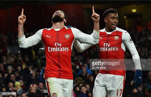 Arsenal's French striker Olivier Giroud celebrates scoring his team's first goal during the English Premier League football match between Arsenal and...